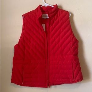 Red puffer jacket with button and pocket detail